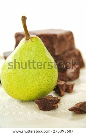 Brown chocolate chunk block and fresh pear. This is perfect harmony of tasting flavor chocolate and pear for cake, muffin, ice cream, fondue, pie, cookies and your favorite desserts.