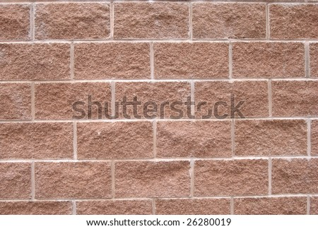 Brown cinder-block wall background - stock photo