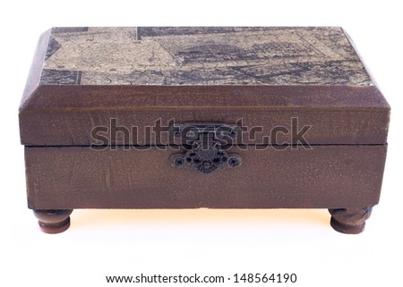 Brown closed wood jewelry box upper view isolated on white background - stock photo