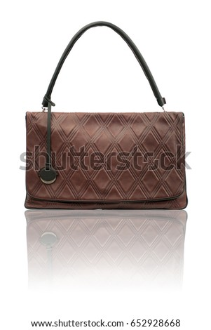 Brown clutch on reflected surface.Isolated on white background.Front view.