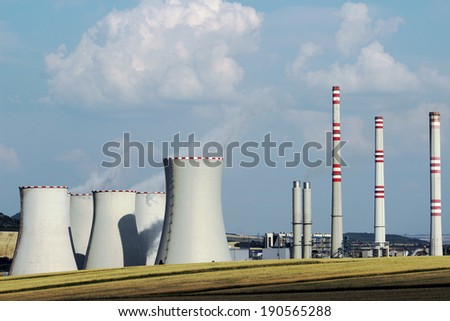 brown coal power plant station in the field - stock photo