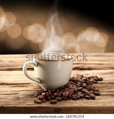 brown coffee and brown coffee beans  - stock photo