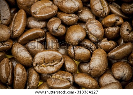 Brown coffee background texture. roasted coffee beans.
