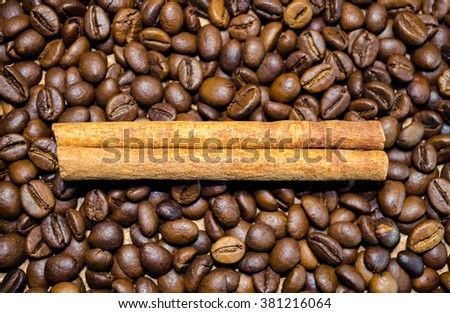Brown coffee beans and cinnamon sticks background