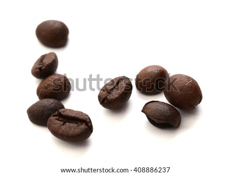 brown coffee beans with green leaf