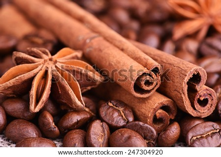 Brown coffee, cinnamon and star anise on the table - stock photo