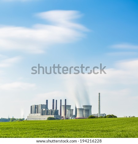 brown cole power station in summer with blue cloudy sky industrial plant - stock photo