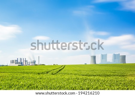 brown cole power stations on a agriculture landscape in summer