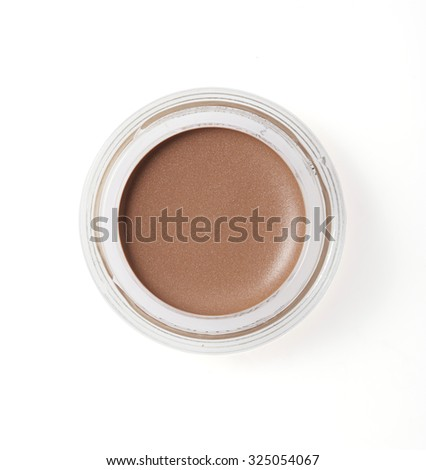 Brown color cheek make up in round container on background