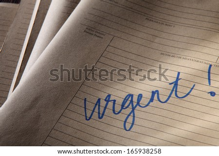 brown color file with word urgent  - stock photo
