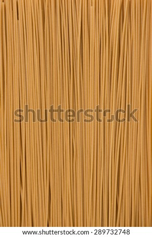 brown color, gluten free spaghetti made with quinoa and brown rice, background, close-up, top view, vertical - stock photo