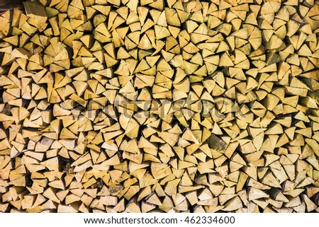 Brown color wood background. Horizontal image of many dry chopped firewood in storage ready for use.