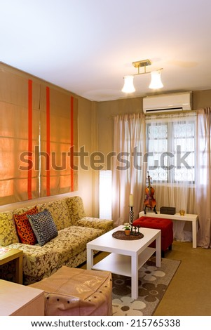 brown contemporary living room, simple furniture for modern living - stock photo