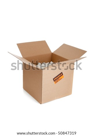 Brown corrugated, cardboard moving box on white with copy space - stock photo