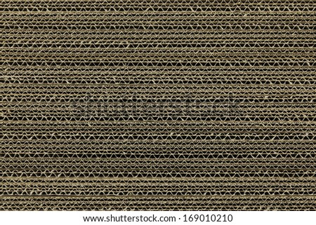 Brown corrugated cardboard one above the other - stock photo