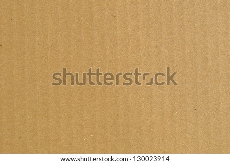 Brown corrugated cardboard sheet background material texture - stock photo