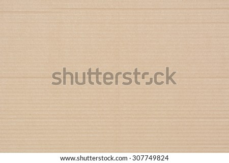 Brown corrugated cardboard texture as a background. - stock photo