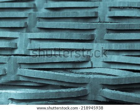 Brown corrugated cardboard used as packaging - cool cyanotype - stock photo