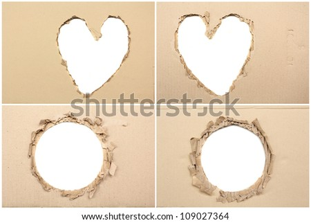 brown corrugated paper torn in the center - stock photo