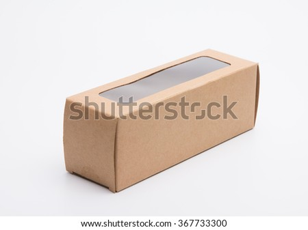 Brown craft paper board box with window covered PVC plastic - stock photo
