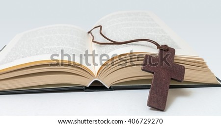 Brown cross and Holy Bible.