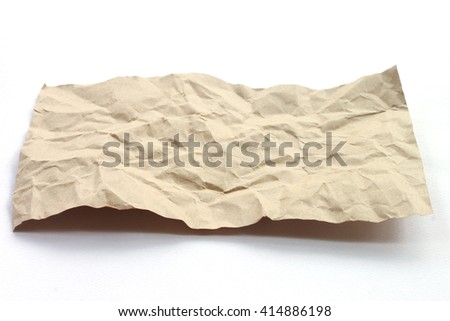 Brown crumpled paper texture on white background. - stock photo