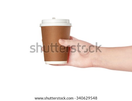 Brown cup of coffee in hand - stock photo