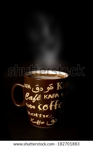Brown cup of coffee isolated on black background