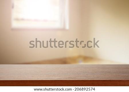 brown desk and sun light  - stock photo
