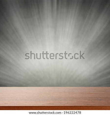brown desk gray wall and light  - stock photo