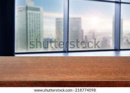 brown desk of free space for you with window view and landscape of city  - stock photo