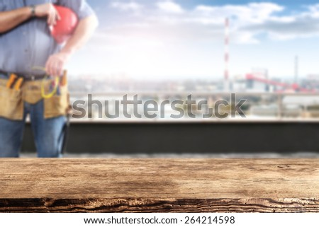 brown desk worker and city landscape  - stock photo