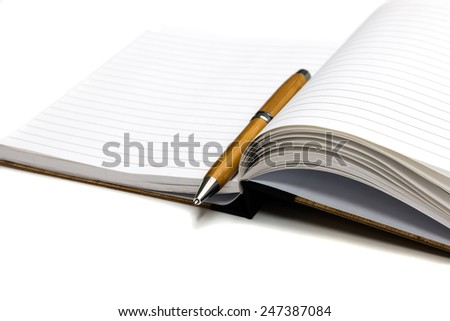 brown diary book and  pen with wood texture design - stock photo