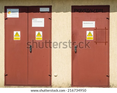 Brown doors of electrical room on railway station in Poland - stock photo