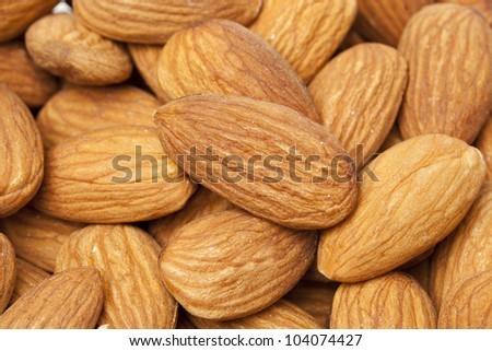 Brown dried almonds background