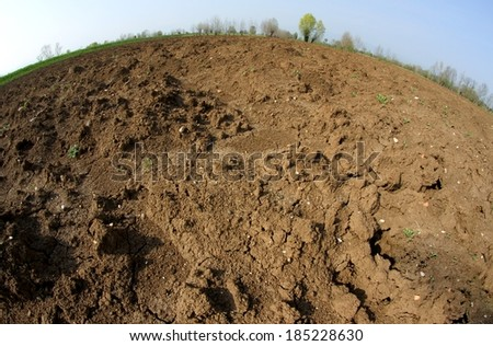 Brown Earth from the farmer ploughed before sowing the seeds for the autumn harvest - stock photo