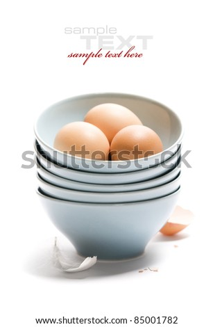 Brown Eggs in a blue bowl - stock photo