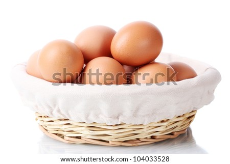 brown eggs in basket isolated on white
