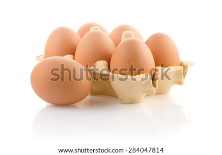 Brown eggs in carton on white with clipping path - stock photo