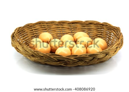Brown eggs in the basket isolated on white background - stock photo