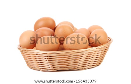Brown eggs in the basket on a white