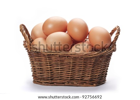 Brown eggs in the basket on white - stock photo