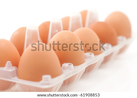 Brown eggs in the box isolated (soft focus) - stock photo