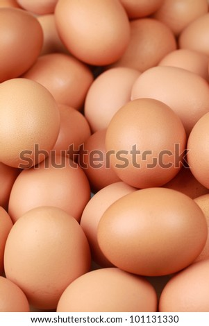 Brown eggs one upon the other with selective focus. - stock photo