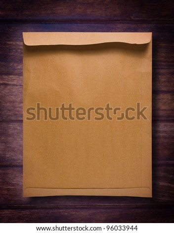 Brown Envelope document on old wood - stock photo