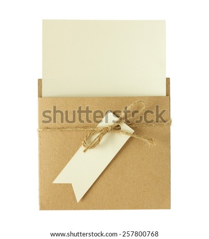Brown envelope of recycle paper with a blank greeting card isolated on white background. - stock photo