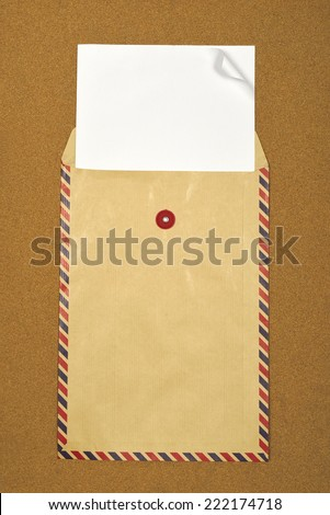Brown envelope on brown background. Put your design on the paper - stock photo
