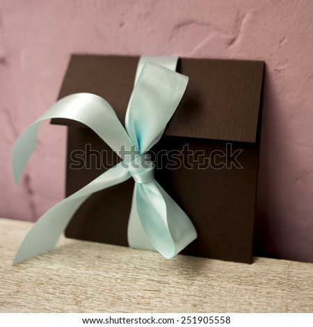 brown envelope with blue ribbon handmade - stock photo