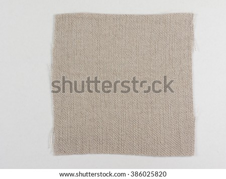 Brown fabric swatch over white background