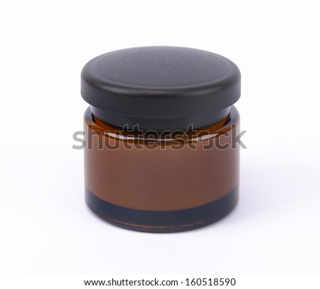 Brown face cream jar - stock photo